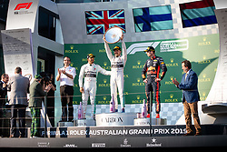 March 17, 2019 - Albert Park, VIC, U.S. - ALBERT PARK, VIC - MARCH 17: Mercedes-AMG Petronas Motorsport driver Valtteri Bottas (77) holds up the winners trophy and is congratulated by his team mate Mercedes-AMG Petronas Motorsport driver Lewis Hamilton (44) at The Australian Formula One Grand Prix on March 17, 2019, at The Melbourne Grand Prix Circuit in Albert Park, Australia. (Photo by Speed Media/Icon Sportswire) (Credit Image: © Steven Markham/Icon SMI via ZUMA Press)