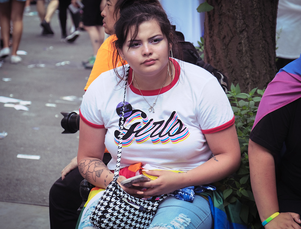 "Girl wearing ""girls"" shirt."