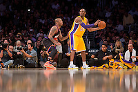 12 February 2013: Guard (24) Kobe Bryant of the Los Angeles Lakers looks to pass while being guarded by (17) P.J. Tucker of the Phoenix Suns during the first half of the Lakers 91-85 victory over the Suns at the STAPLES Center in Los Angeles, CA.