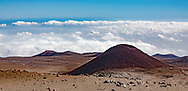 Volcanic landscape near the summit of Mauna Kea, with cloud layers below and an evident transition to the cold dry air at high altitude. Big Island, Hawaii,  © 2010 David A. Ponton
