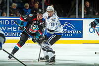 KELOWNA, CANADA - OCTOBER 4: Dillon Dube #19 of the Kelowna Rockets checks Eric Florchuk #14 of the Victoria Royals on October 4, 2017 at Prospera Place in Kelowna, British Columbia, Canada.  (Photo by Marissa Baecker/Shoot the Breeze)  *** Local Caption ***