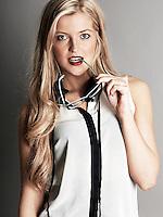 Half length shot of pretty blonde girl in white top