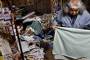 Kawasaki, November 21 2014 - Japanese artist Tatsumi ORIMOTO, 69, at home taking care of his 97-year-old mother.