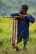 A boy leans against a wooden bicycle Kanyabayonga, Eastern Democratic Republic of Congo, on Thursday December 11, 2008..