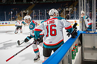 KELOWNA, CANADA - JANUARY 3: Kole Lind #16 of the Kelowna Rockets scoops the warm up pucks off the boards onto the ice against the Tri-City Americans on January 3, 2017 at Prospera Place in Kelowna, British Columbia, Canada.  (Photo by Marissa Baecker/Shoot the Breeze)  *** Local Caption ***
