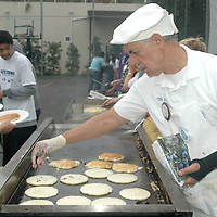 Mike Cortrite makes  pancakes during  Santa Monica Lions Club 57th Annual Pancake Breakfast at the Santa Monica Boys and Girls Club on Saturday, September 24, 2011.