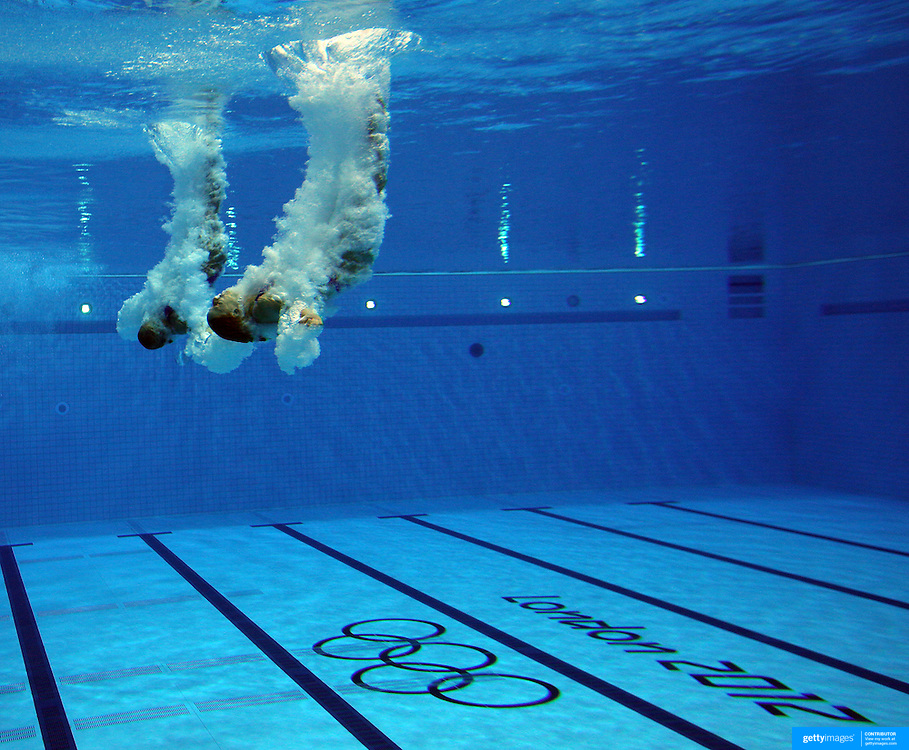 Synchronised divers in action during the Women's Synchronised 3m springboard diving competition at the Aquatic Centre at Olympic Park, Stratford during the London 2012 Olympic games. London, UK. 29th July 2012. Photo Tim Clayton