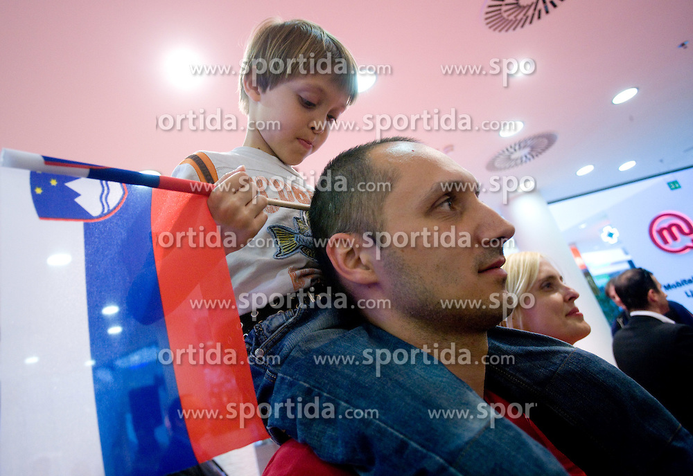 Young fan with Slovenian flag and his father at visit  of Slovenian National Football team in Mobitel center, on May 19, 2010 in Ciytpark, BTC, Ljubljana, Slovenia. (Photo by Vid Ponikvar / Sportida)