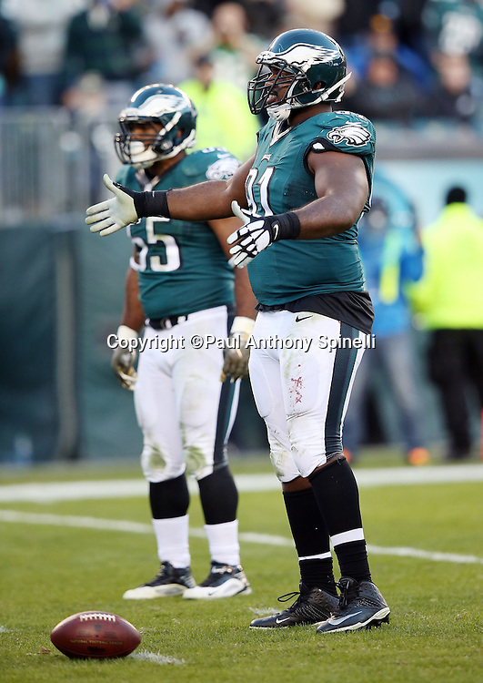 Philadelphia Eagles defensive end Fletcher Cox (91) waves his arms as he fires up the fans during the 2015 week 10 regular season NFL football game against the Miami Dolphins on Sunday, Nov. 15, 2015 in Philadelphia. The Dolphins won the game 20-19. (©Paul Anthony Spinelli)