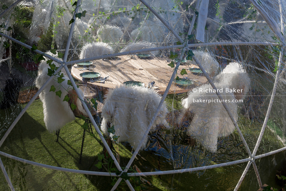 Places are set for customers inside a geodesic dome of an outdoor restaurant on the Thames waterfront at Kingston, on 7th November 2019, in London, England. A geodesic dome is a hemispherical thin-shell structure (lattice-shell) based on a geodesic polyhedron.