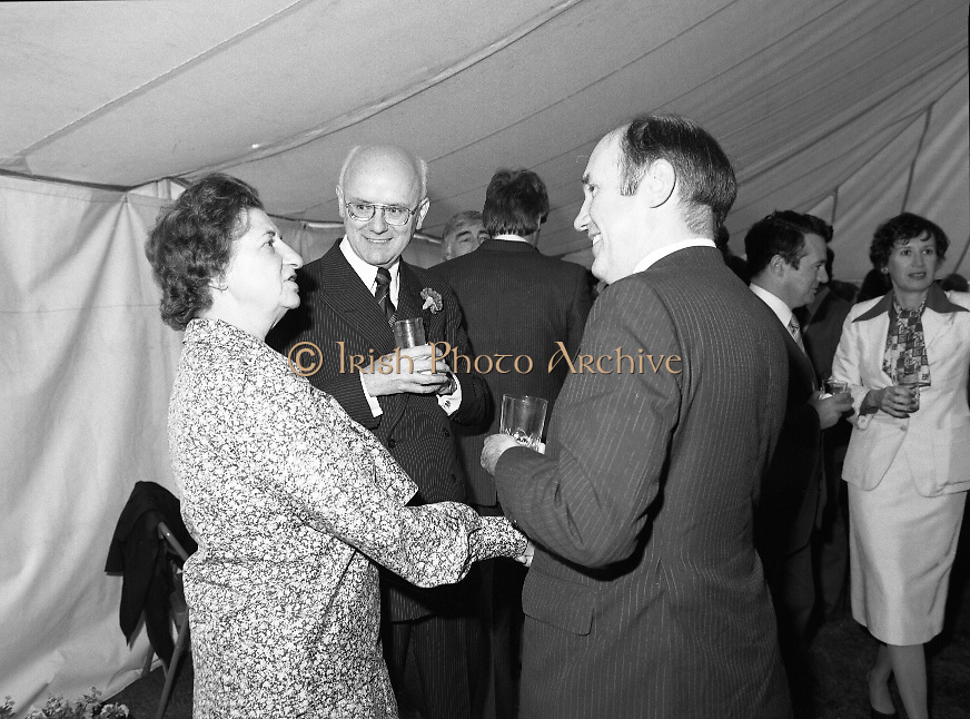 Guests and staff at the US Embassy in Phoenix Park, Dublin, celebrate American Independence Day..1980-07-04.4th July 1980.04/07/1980.07-04-80..Photographed at the US Ambassador's Residence,  Phoenix Park...US Ambassador William V Shannon chats with a guest in marquee during festivities. His wife Elizabeth McNelly Shannon is to the far right of the photo.