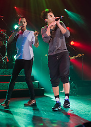 """© Licensed to London News Pictures. 01/03/2014. London, UK.   Rizzle Kicks performing live at Hammersmith Apollo. In this picture - Harley Alexander-Sule (left), Jordan Stephens (right).  Rizzle Kicks are an English hip hop duo from Brighton, consisting of Jordan """"Rizzle"""" Stephens and Harley """"Sylvester"""" Alexander-Sule.   Photo credit : Richard Isaac/LNP"""
