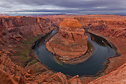 A cloudy morning at Horseshoe Bend along the Colorado River near Page, Arizona.