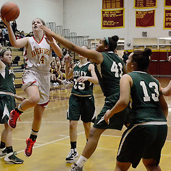 TOM KELLY IV &mdash; DAILY TIMES<br /> Haverford's Mollie Reynolds (14) goes up for a layup past Ridley's Izzy Hamlin (41) and Kristin Saraceni (2) during the Ridley at Haverford girls basketball game, Friday night.