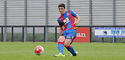 Jake Gray plays the ball out wide during the U21 Professional Development League match between Crystal Palace U21s and Huddersfield U21s at Imperial Fields, Tooting, United Kingdom on 7 September 2015. Photo by Michael Hulf.