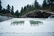 Snow blankets empty benches in the volcanic crater amphitheater, venue of the populat summer evening music concert series.  Mount Tabor Park, Portland, Oregon, USA. Nikon D700.  Nikon AF Nikkor 18mm f/2.8D.