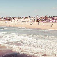 Huntington Beach retro panorama photo of the Southern California coastline. Panoramic photo ratio is 1:3. Huntington Beach is also known as Surf City USA and is a seaside beach city along the Pacific Ocean in Orange County.