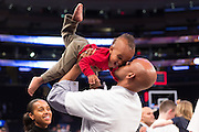 George Washington Associate Head Coach Hajj Turner kisses his son after GWU won the NIT championship at Madison Square Garden in New York, NY, on Thursday, March 31, 2016.