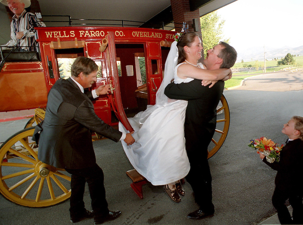 A young couple exits a stagecoach after getting married. Photo by August Miller