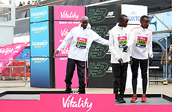 Mo Farah winner of the men's race (left) with Bashir Abdi who finished secoond (right) and Daniel Wanjiru who finished third during the Vitality Big Half in London.