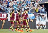 Argentina's Gonzalo Higuain, center, celebrates with Nicolas Gaitan, left, and Leo Messi after scoring for a partial result of 2-0 over Venezuela during the Copa America Centenario 2016 in Foxborough, Massachusetts, Saturday June 18, 2016.