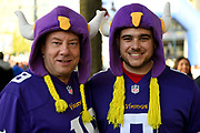 Two Minnesota Vikings fans wearing team hats with horns during the International Series match between Los Angeles Rams and Cincinnati Bengals at Wembley Stadium, London, England on 27 October 2019.