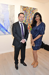 ANDREW LACEY and ANSHU BAHANDA at a private view of the exhibition Transcending Boundaries 2015 held at Lacey Contemporary Gallery, Clarendon Cross, Notting Hill, London on 30th April 2015.