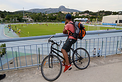AUBAGNE, FRANCE - Monday, May 29, 2017: A cyclist stops to watch England take on Angola during the Toulon Tournament Group A match between England U18 and Angola U20 at the Stade de Lattre-de-Tassigny. (Pic by David Rawcliffe/Propaganda)