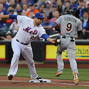 Lucas Duda, (left), New York Mets, catches the ball thrown to first as Dee Gordon, Miami Marlins, attemts to get to first on an infield hit. The play was ruled safe and upheld after review during the New York Mets Vs Miami Marlins MLB regular season baseball game at Citi Field, Queens, New York. USA. 18th April 2015. Photo Tim Clayton