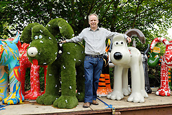 © Licensed to London News Pictures. 28/06/2013. Bristol, UK. Nick Park of Aardman Animations who created Gromit when he was a student, with some of the Gromit Unleashed sculptures in Bristol.  From Monday 1st July, Bristol will be home to 80 iconic giant Gromit sculptures as our public arts trail Gromit Unleashed takes to the streets.  The 5 foot high sculptures which have been painted by artists will be placed in various locations around Bristol and will eventually be auctioned for charity.  All proceeds from Gromit Unleashed will benefit Wallace & Gromit's Grand Appeal, the Bristol Children's Hospital Charity.  26 June 2013.<br />
