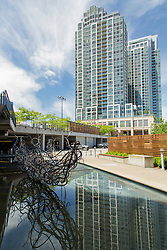 United States, Washington, Bellevue, sculpture and skycraper reflected in pool