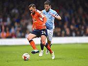 Luton Town player Lawson D'Ath protects the ball in the first half during the EFL Sky Bet League 2 play off second leg match between Luton Town and Blackpool at Kenilworth Road, Luton, England on 18 May 2017. Photo by Ian  Muir.