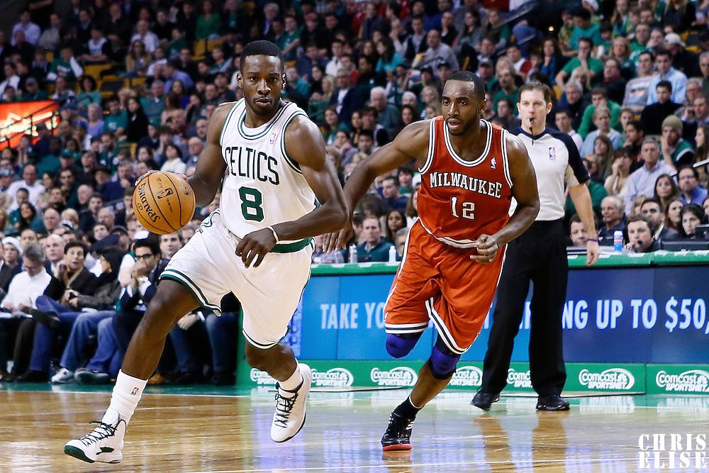 21 December 2012: Boston Celtics power forward Jeff Green (8) drives past Milwaukee Bucks power forward Luc Richard Mbah a Moute (12) during the Milwaukee Bucks 99-94 overtime victory over the Boston Celtics at the TD Garden, Boston, Massachusetts, USA.