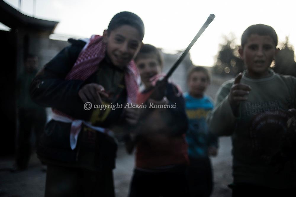 SYRIA - Al Qsair. Syriran children play with an airgun in a street of Al  Qsair, on February 13, 2012. ALESSIO ROMENZI