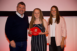 NEWPORT, WALES - Saturday, May 19, 2018: Mia Rawling is presented with her Under-16's cap by Osian Roberts (left) and Lauren Dykes (right) during the Football Association of Wales Under-16's Caps Presentation at the Celtic Manor Resort. (Pic by David Rawcliffe/Propaganda)