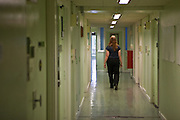 A prisoner walks down one of the wing corridors at HMP Holloway, the main womens prison in London.