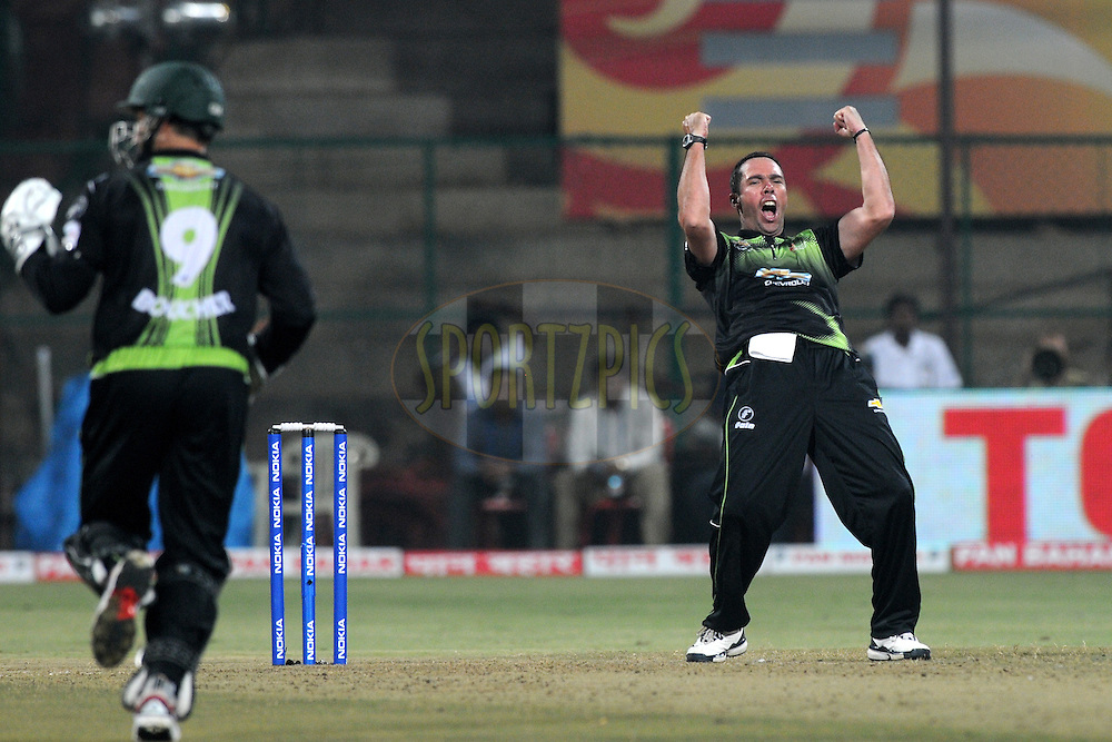 Nicky Boje of Warriors celebrates a wicket during match 1 of the NOKIA Champions League T20 ( CLT20 )between the Royal Challengers Bangalore and the Warriors held at the  M.Chinnaswamy Stadium in Bangalore , Karnataka, India on the 23rd September 2011..Photo by Pal Pillai/BCCI/SPORTZPICS