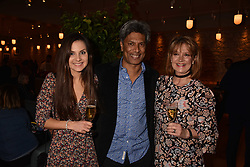 Des Gunewardena, his wife Liz and daughter Saskia Gunewardena at the launch of Fiume at Battersea Power Station, Battersea, London England. 16 November 2017.<br /> Photo by Dominic O'Neill/SilverHub 0203 174 1069 sales@silverhubmedia.com