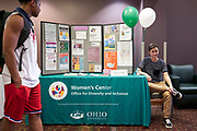 Leigh Ferrero waiting to talk to students at the Women's Center booth.