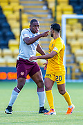 Uche Ikpeazu (#19) of Heart of Midlothian FC takes issue with Aymen Souda (#20) of Livingston FC during the Ladbrokes Scottish Premiership match between Livingston FC and Heart of Midlothian at the Tony Macaroni Arena, Livingston, Scotland on 26 October 2019.