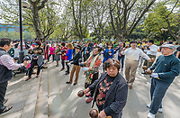 Shanghai, China - April 7, 2013: people playing maracas in fuxing park at the city of Shanghai in China on april 7th, 2013