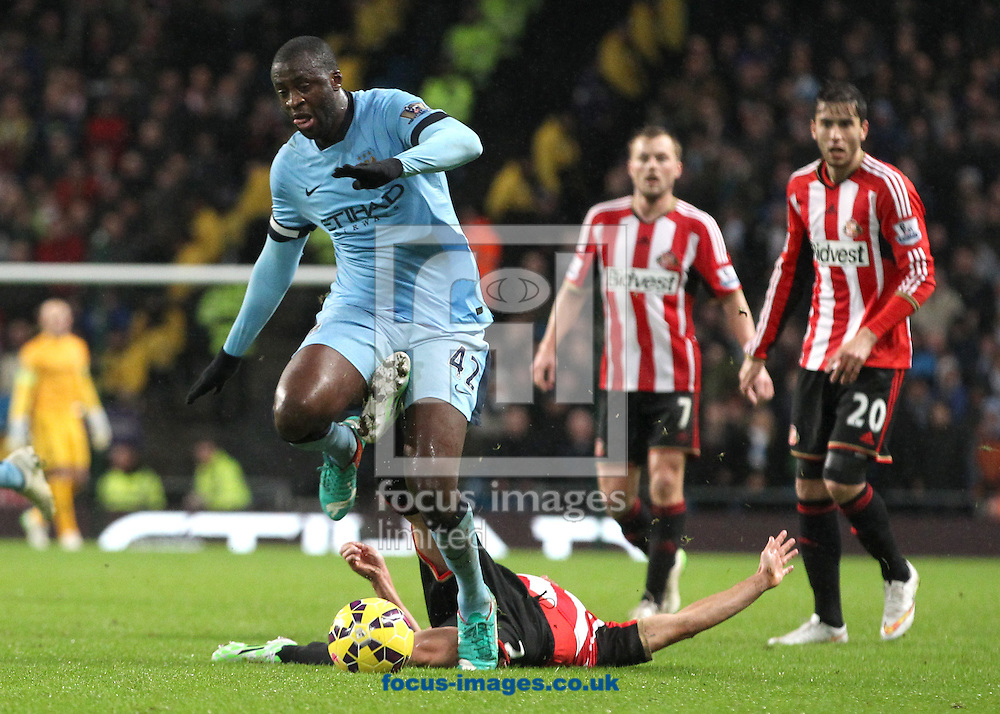 Yaya Toure of Manchester City and Wes Brown of Sunderland in action during the Barclays Premier League match at the Etihad Stadium, Manchester.<br /> Picture by Michael Sedgwick/Focus Images Ltd +44 7900 363072<br /> 01/01/2015