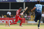 Lendl Simmons of Trinidad &amp; Tobago looks back as his bails fall during match 16 of the Karbonn Smart Champions League T20 (CLT20) 2013  between The Titans and Trinidad and Tobago held at the Sardar Patel Stadium, Ahmedabad on the 30th September 2013<br /> <br /> Photo by Ron Gaunt-CLT20-SPORTZPICS  <br /> <br /> Use of this image is subject to the terms and conditions as outlined by the CLT20. These terms can be found by following this link:<br /> <br /> http://sportzpics.photoshelter.com/image/I0000NmDchxxGVv4