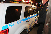 New York, NY-MARCH 13 :  The Kimani Gray vigil turns violent when protestors react to the heavy NYPD presence during the vigil. A number of protestors were arrested for disorderly conduct including a relative of the slain 16 year-old, Kimani Gray who was gunned down by plainclothes unidentified NYPD Officers. A large crowd gathered to hear words during the vigil, but were angered by Poilce in riot gear standing near memorial on the corner of East 55th street and Church Avenue in Brooklyn, NY on March 13, 2013.  © Terrence Jennings