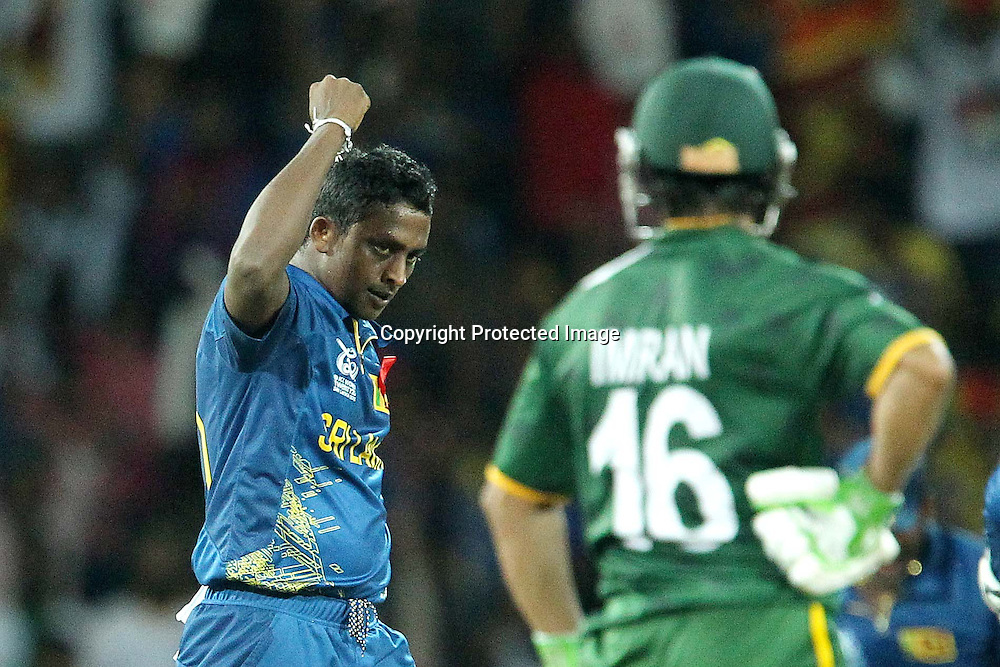 Ajantha Mendis celebrates the wicket of  Imran Nasir during the ICC World Twenty20 semi final match between Sri Lanka and Pakistan held at the Premadasa Stadium in Colombo, Sri Lanka on the 4th October 2012<br /> <br /> Photo by Ron Gaunt/SPORTZPICS