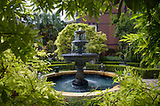 Fountain in the garden of the Calhoun Mansion on Meeting Street in Charleston, SC. Charleston founded in 1670 is considered America's most beautifully preserved architectural and historic city.