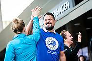 A runner from Sparta Atletik gives a high-five to a delegate taking part in the 2019 INSOL Europe Annual Congress at Scandic Copenhagen. <br /> <br /> © Images Copyright Copenhagen Event Photographer Matthew James