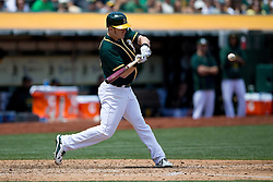 OAKLAND, CA - JULY 23:  Mark Canha #20 of the Oakland Athletics at bat against the Toronto Blue Jays during the fourth inning at O.co Coliseum on July 23, 2015 in Oakland, California. The Toronto Blue Jays defeated the Oakland Athletics 5-2. (Photo by Jason O. Watson/Getty Images) *** Local Caption *** Mark Canha