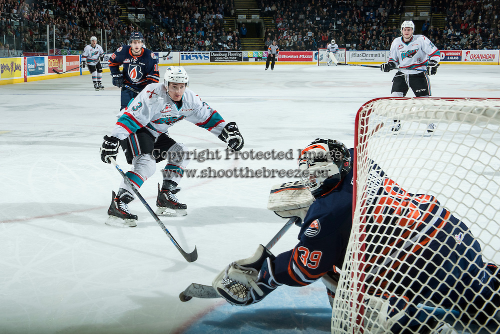 KELOWNA, CANADA - MARCH 25: Connor Ingram #39 of Kamloops Blazers makes a save on a shot by Riley Stadel #3 of Kelowna Rockets on March 25, 2016 at Prospera Place in Kelowna, British Columbia, Canada.  (Photo by Marissa Baecker/Shoot the Breeze)  *** Local Caption *** Connor Ingram; Riley Stadel;