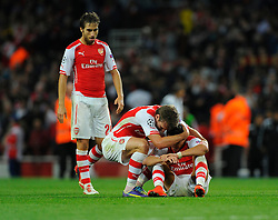 Arsenal's Alexis Sanchez in congratulated by Arsenal's Nacho Monreal and Arsenal's Mathieu Flamini on the final whistle - Photo mandatory by-line: Joe Meredith/JMP - Mobile: 07966 386802 27/08/2014 - SPORT - FOOTBALL - London - Emirates Stadium - Arsenal v Besiktas - Champions League